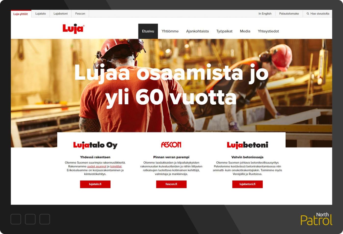 Kuvakaappaus Luja.fi -verkkosivuista. Kuvituskuva työntekijöistä rakentamassa, linkit alasivustoihin.
